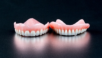 Two full dentures sitting side by side