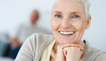 woman with perfect dentures smiling