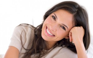 woman with a beautiful smile thanks to porcelain veneers los angeles loves