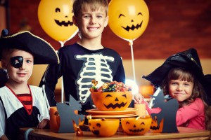 Kids celebrating Halloween with lots of candy. fight cavities with help from your los angeles dentist