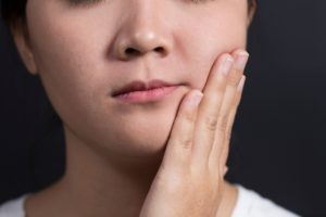 person with mouth pain who needs emergency dentist in Los Angeles