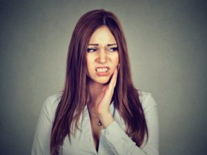 Pained woman needs root canal therapy in Los Angeles