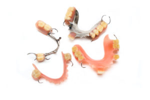 Several different types of dentures in Los Angeles on white background